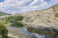 Columnar jointed volcanic rocks. Around Arda River behind the Studen Kladenets Cold well dam, Bulgaria stock photography
