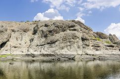 Columnar jointed volcanic rocks. Around Arda River behind the Studen Kladenets Cold well dam, Bulgaria royalty free stock photo