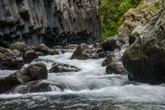 Columnar jointed volcanic rocks and river, la Reunion Royalty Free Stock Photography