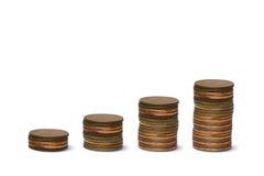 Columnas cada vez mayores de monedas Foto de archivo