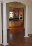 Columned archway. Between dining room and kitchen in new home Stock Photos