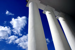 Columns. White columns in blue background of sky stock photos