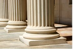 Columns. Base of white, marble columns stock photography