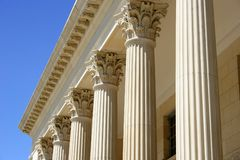 Columns. Row of white columns against bright blue sky royalty free stock photos