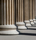 Columns. Stable columns in bright sunlight Stock Photography