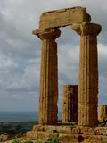 Columns 3. Columns of a Greek temple in Agrigento, Sicily, Italy with sea backdrop Royalty Free Stock Images