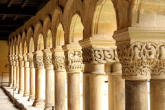 Columns. In a line in a courtyard of monastery of cathedral La Colegiata in Santillana del Mar, Cantabria, arches royalty free stock photo