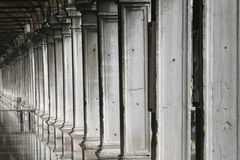 Columns. Ancient columns led down a hall to Saint Marco Square in Venice Italy Stock Photo