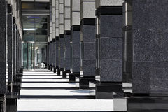 Columns along office walkway Stock Photography