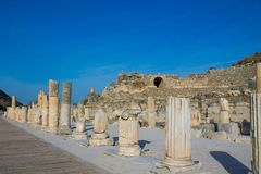Columns in ancient antique city of Efes, Ephesus ruins. Ancient antique city of Efes Celsus library ruin in Turkey. Ancient Greek city Ephesus ruins on the stock photography