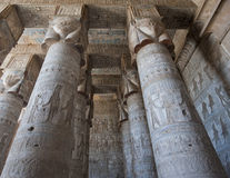 Columns in an ancient egyptian temple. Columns inside an ancient egyptian temple covered in hieroglyphic carvings and paintings Stock Photos