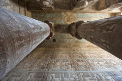 Columns in an ancient egyptian temple. Columns inside an ancient egyptian temple covered in hieroglyphic carvings and paintings Stock Photo