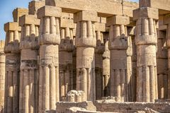 Columns of the ancient Egyptian temple on the blue sky background stock images