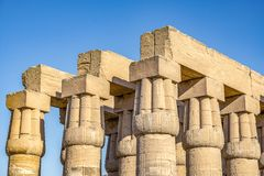 Columns of the ancient Egyptian temple on the blue sky background in Luxor stock image