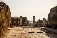 Columns by Ancient Pompeii Road Stock Photography