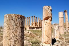 Columns at ancient ruins. Preserved pillars and columns at the ruined ancient Greco-Roman city of Gerasa in Jordan Stock Images
