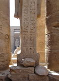 Columns with ancient stone carved egyptian hieroglyphics Royalty Free Stock Photos