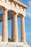 Columns of Aphaia. A view of the Doric temple of Aphaia on Aegina island in the Saronic Gulf, south of Athens, showing some of the modern repairs. Aphaia appears Stock Photos