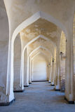 Columns arch corridor. Landmarks in Bukhara. Columns of ancient mosque. Landmarks in Bukhara, Uzbekistan, March 2016 Stock Photo