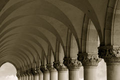 Columns and Arches. Sepia-toned row of arches and columns in Venice Italy stock image