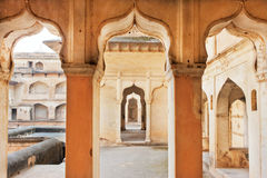 Columns and arches of an ancient palace built in indo-islamic style. India Stock Images