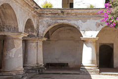 Columns and arches in a convent Stock Images