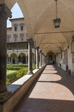 Columns and arches. Long corridor with row of arches and columns and a garden in Venice Italy, near the San Marco square Royalty Free Stock Photo