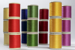 Columns of bobbins of cotton thread Stock Photo