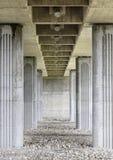 Columns of a bridge. Detail of a bridge seen from below, stone bridge Stock Photos