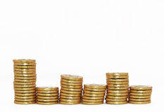 Columns of chocolate gold money coins. Columns of chocolate money coins in a gold wrapper with room for your text Royalty Free Stock Photos
