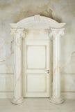 Columns and closed door Stock Photo