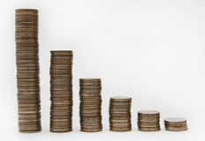 Columns of Coins. Against the Light Background Stock Photo