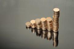 Columns of coins Stock Photos