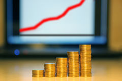 Columns from coins against the schedule Stock Images