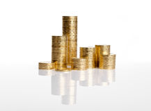 Columns of coins on white Royalty Free Stock Photo