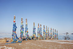 Columns with colorful ribbons on Cape Burhan. Stock Photography