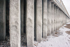 Columns covered with ice on seacoast Royalty Free Stock Image