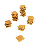 Columns of crackers. Columns of the crispy crackers on a white background Royalty Free Stock Image