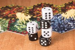Columns of dices on the background of objects for table games stock image