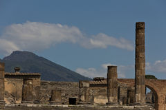 Columns from the excavated forum of Pompeii with Mount Vesuvius Royalty Free Stock Images