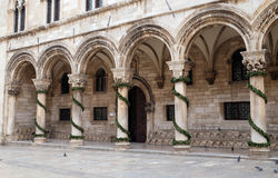 Columns and exterior of the Dukes Palace decorated with Advent wreaths in Dubrovnik Royalty Free Stock Images