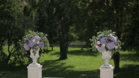 Columns of flowers for wedding ceremony. Sequence stock video