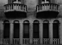 The columns gallery. Shot in black and white, detail on the sculpture on the facade of this historic building representing some characters / animals / flowers Stock Photos