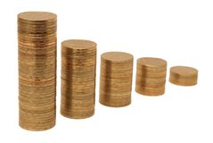 Columns of golden coins. Against a white background Stock Images