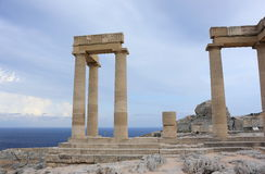Columns of the Hellenistic stoa. Acropolis of Lindos. Rhodes, Greece. Royalty Free Stock Photo