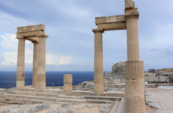 Columns of the Hellenistic stoa. Acropolis of Lindos. Rhodes, Greece. Stock Photos