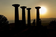Columns on hill. Silhouette capture of ancient greek columns rising on hill of Assos - Kefalonia royalty free stock image