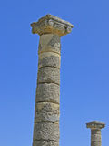 Columns of humanity. Ancient roman columns against a blue sky. Image full of symbolism and connotations durable, strength, humanity, history Royalty Free Stock Image