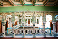 Columns inside the colorful historical mansion Royalty Free Stock Photos
