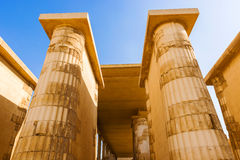 Columns inside Saqqara temple in Egypt. Saqqara is a vast burial ground serving as the necropolis for the Ancient Egyptian capital, Memphis. There are pyramids Royalty Free Stock Photo